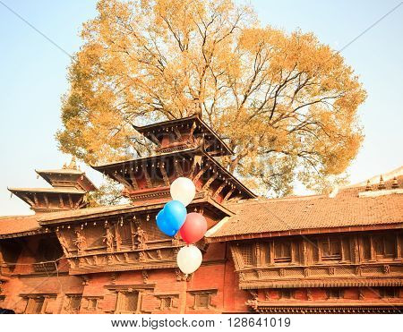 Wooden crafts added artistic Temples with Balloons and Tree in Kathmandu Durbar SquareNepal.