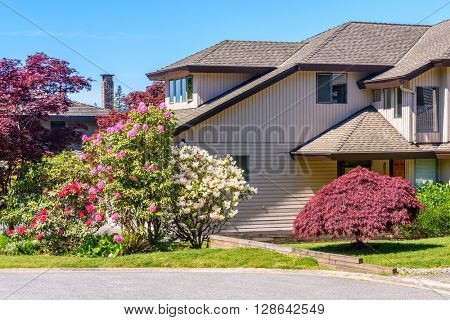 A perfect neighborhood. Fragment of a house in suburb at Spring in the north America.