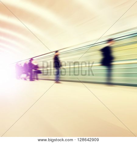 Blurred image of people waiting at subway station.