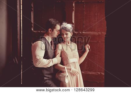 Pretty Embracing Couple On The Vintage Doorway Background.