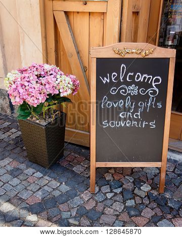 Wooden sign board Natural style shop decoration and inscription invitation to buy souvenirs. Empty space for text.