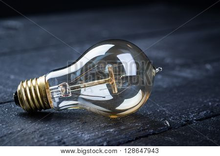 Tungsten Bulb On A Black Table