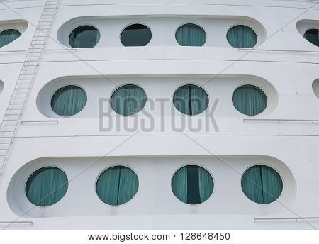 Portholes on the bow of a large luxury cruise ship