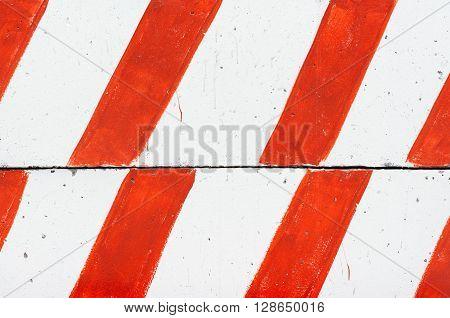striped concrete blocks lie on each other
