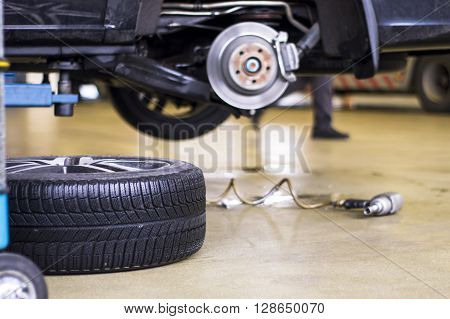 Car Without Tire Need To Be Repaired.