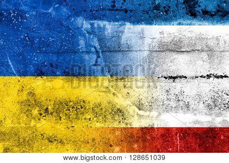 Autonomous Republic Of Crimea And Ukraine Flag Painted On Grunge Wall