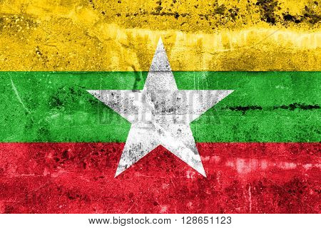 Burma Flag painted on grunge wall. Vintage and old look.