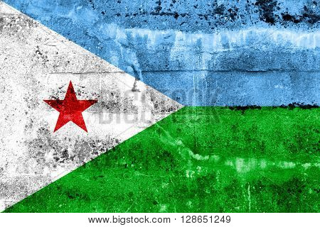 Djibouti Flag painted on grunge wall. Vintage and old look.