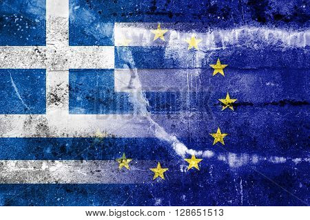 Greece and European Union Flag painted on grunge wall. The economic crisis in Greece. Waving and old look.