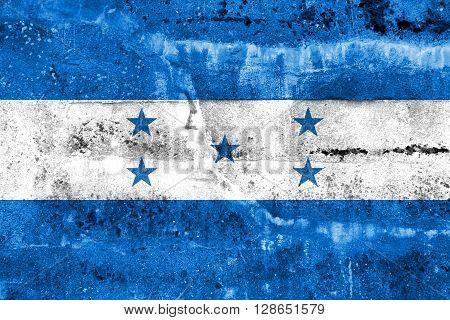 Honduras Flag painted on grunge wall. Vintage and old look