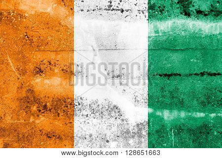 Ivory Coast Flag painted on grunge wall. Vintage and old look.