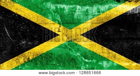 Jamaica Flag painted on grunge wall. Vintage and old look