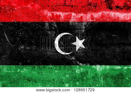 Libya Flag painted on grunge wall. Vintage and old look.