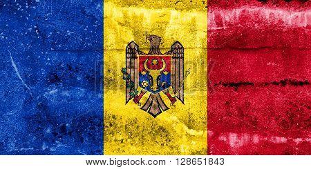 Moldova Flag painted on grunge wall. Vintage and old look
