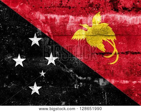 Papua New Guinea Flag Painted On Grunge Wall