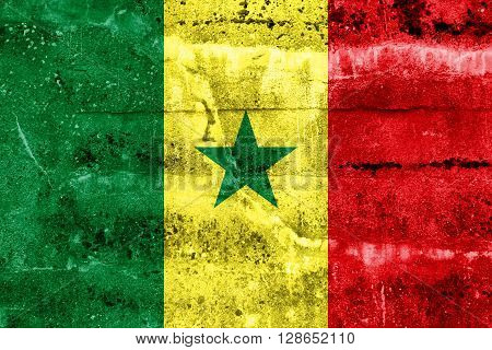 Senegal Flag painted on grunge wall. Vintage and old look