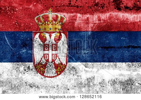 Serbia Flag painted on grunge wall. Vintage and old look