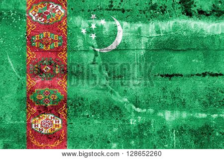 Turkmenistan Flag painted on grunge wall. Vintage and old look