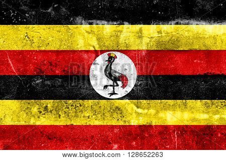 Uganda Flag painted on grunge wall. Vintage and old look