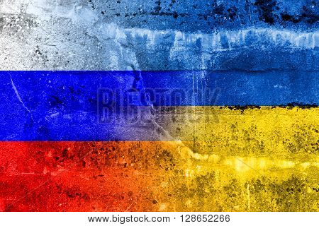 Ukraine And Russia Flag Painted On Grunge Wall