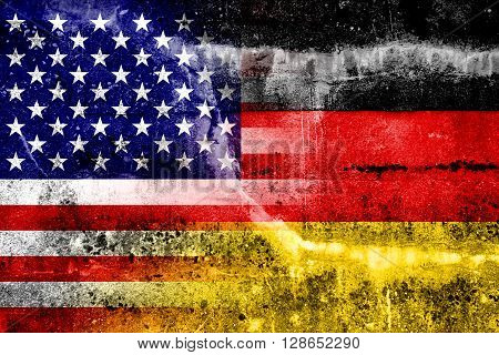 USA and Germany Flag painted on grunge wall. Vintage and old look.
