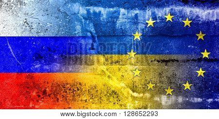 Ukraine, Eu And Russia Flag Painted On Grunge Wall