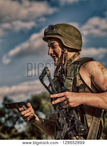 young a soldier in the uniform with weapon ** Note: Soft Focus at 100%, best at smaller sizes