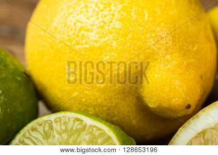 Fresh And Juicy Lemons And Lime On A Wooden Surface