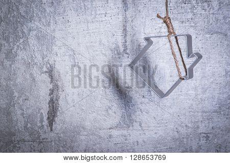 Metal Figure Of House In A Hangmans Loop