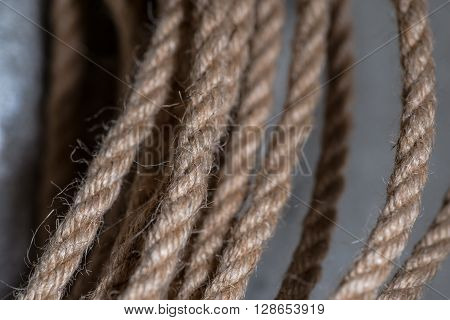 Old jute rope over the concrete wall