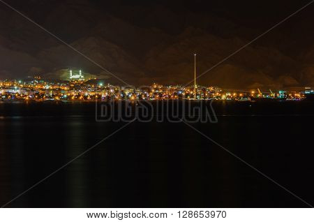 Aqabah, the Jordanian seaport city at night, as seen from the neighbouring city Eilat of Israel.