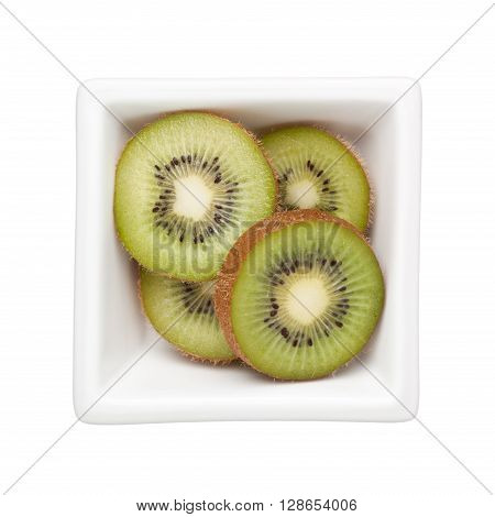 Sliced kiwifruit in a square bowl isolated on white background