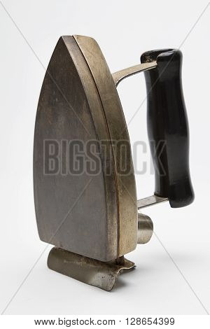 Side view of an antique electric iron