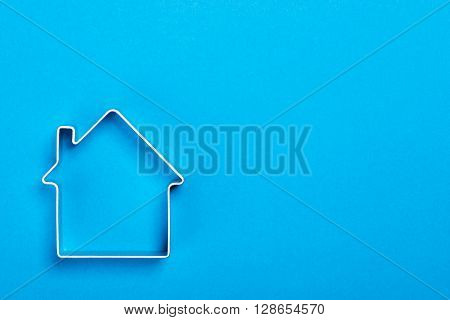 Metal House Standing On A Blue Surface