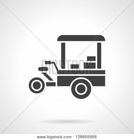 Mobile tricycle shop with awning. Street trade object. Snack and beverages sale. Symbolic black glyph style vector icon. Elements for web design and mobile.