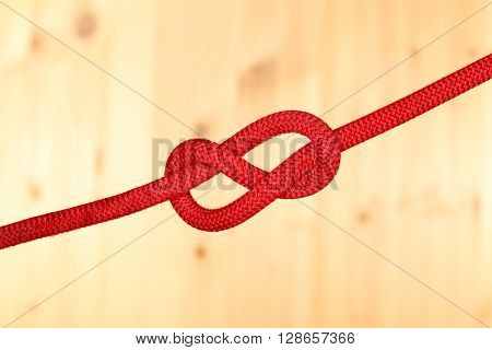 red rope with knot in the middle