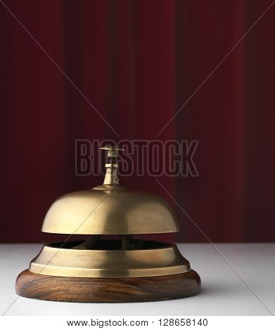 Chrome Bell on a Hotel reception with a red background