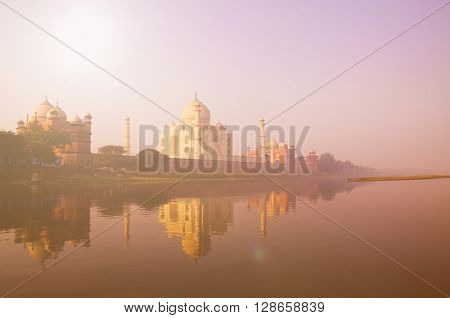 Beautiful Scenery Of Taj Mahal And A Body Of Water Concept