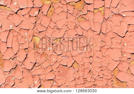 Concrete red cracked wall as a grunge background