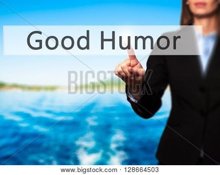 Good Humor - Businesswoman Hand Pressing Button On Touch Screen Interface.