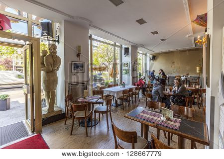 People Enjoy Cafe At The Cafe Sybille.