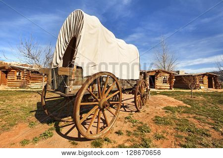 old covered wagon in a pioneers' village