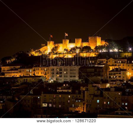 The glow of the landmarks in lisbon portugal at night