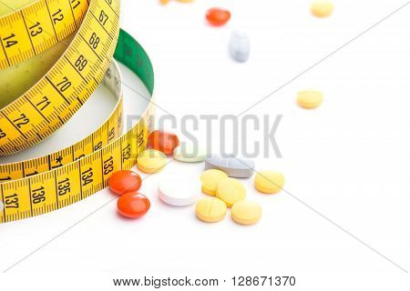 Fresh Green Apple With Measuring Tape And Pills