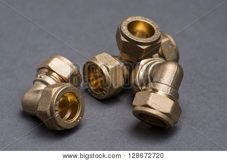 Brass Plumbing Compression Fittings On Grey Table