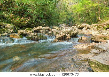 Cascade on mountain river Agura in Sochi Krasnodar Krai Russia HDR processing