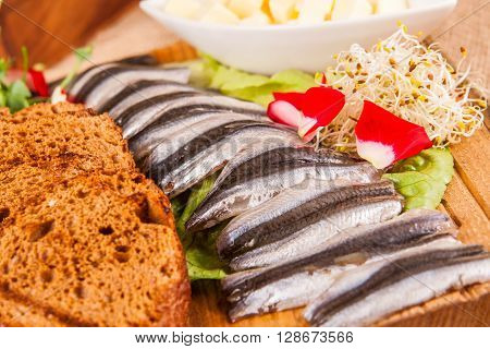 Caspian sprat with toasted rye bread and butter