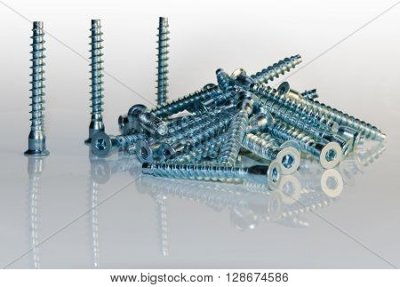 background of a large number of furniture screws