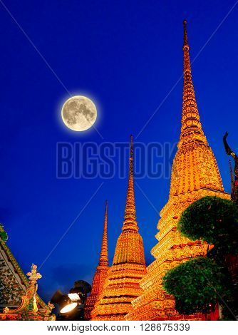 Full moon and Wat Pho Temple Bangkok Thailand. Wat Pho known also as the Temple of the Reclining Buddha.