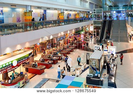 DUBAI, UAE - MARCH 10, 2015: inside of Dubai International Airport. Dubai International Airport is the primary airport serving Dubai, United Arab Emirates